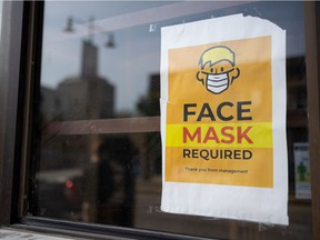 A face mask required sign is taped to a window of a downtown business in Saskatoon. Photo taken in Saskatoon on Thursday, September 9, 2021.