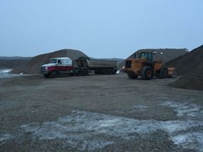A photo taken by RCMP of Sheree Fertuck's semi and loader left at the gravel pit near Kenaston where she was last seen. (Court exhibit photo)