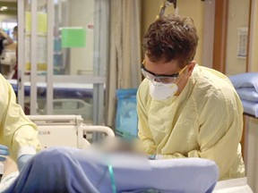 Calgary ICU staff speak with a COVID-19 patient to determine if there is anyone they would like staff to call.