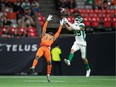 B.C. Lions' KiAnte Hardin (37) breaks up a pass intended for Saskatchewan Roughriders' Kian Schaffer-Baker (89) during the first half of Friday's game at BC Place. THE CANADIAN PRESS/Darryl Dyck