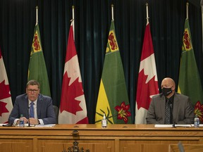 Premier Scott Moe, left, and Saskatchewan Public Safety Agency president Marlo Pritchard speak during a COVID-19 update at the Legislative Building, where no new public health restrictions were announced on Thursday.