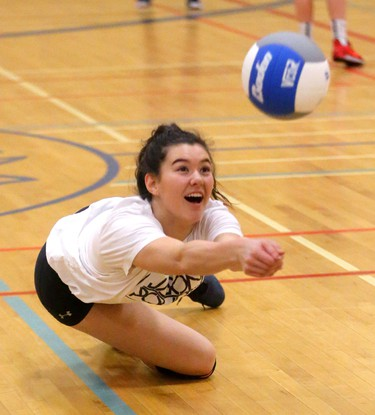 Natalie Lyons, a co-captain of the Oakridge girls volleyball team warms up at practice in London, Ont.  They will be the second seed at the OFSAA tournament they host, starting Monday morning. Photograph taken on Thursday March 1, 2018.  Mike Hensen/The London Free Press/Postmedia Network