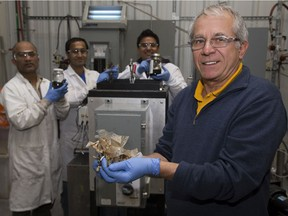 Franco Berruti and his team — Mohammad Hossain, left, Sonil Nanda and Frabricio Guayaquil — use pyrolysis machines to break down waste into oils, gases and char at Western University's Institute for Chemicals and Fuels from Alternative Resources. (Derek Ruttan/The London Free Press)