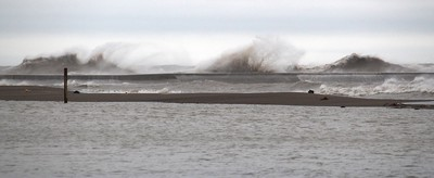 Lake Erie waves crash over the pier in Erieau, Ont. on Sunday. Ellwood Shreve/Chatham Daily News/Postmedia Network