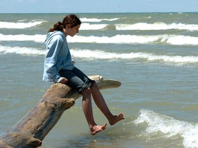 Alexandria Gillett tests the water at the beach at Pinery Provincial Park. (File photo)