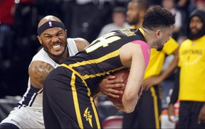 Halifax Hurricanes' Tyrone Watson and London Lightning's Ryan Anderson struggle for the ball  in Game 2 of the National Basketball League of Canada best-of-seven final Tuesday in Halifax. The Hurricanes won 100-91 to take a 2-0 series lead. ERIC WYNNE/Chronicle Herald