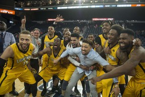 The London Lightning get ready to hoist the championship trophy after their 109-101 victory over the Halifax Hurricanes in Game 7 of the NBL Canada finals. (RYAN TAPLIN / The Chronicle Herald)