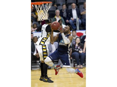 Antoine Mason of the Halifax Hurricanes sails past Doug Herring Jr. of the London Lightning on way to a lay up during Game 3 of their NBL of Canada championship series in London, Ont. on Thursday May 10, 2018. (Derek Ruttan/The London Free Press)
