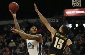 Halifax Hurricanes Tyron Watson lays one up for a deuce against London Lightning's Garrett Williamson during NBL of Canada playoff action in Halifax Sunday. (Tim Krochak/ The Chronicle Herald)