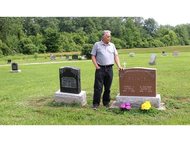 Bryan Prince stands at the gravesite of his parents in the cemetery of the North Buxton Community Church in North Buxton on Tuesday. Ellwood Shreve/Postmedia Network