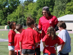 Luke Willson gathers his team for a group huddle during a game of flag football at London's Jumpstart Games on Friday. (SHANNON COULTER, The London Free Press)