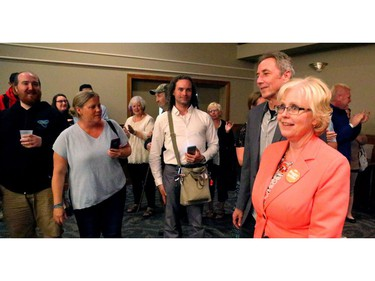 Peggy Sattler won London West for the NDP Thursday night in a mini-Orange Crush in the Forest City. She is accompanied by her husband Neil Bradford.  Mike Hensen/The London Free Press/Postmedia Network