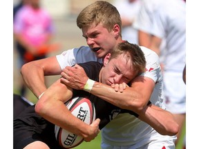 Ian Bennett of the Medway Cowboys stops the run of Oakville Trafalgar's Andrew Easson during their OFSAA AAA boys rugby semifinal at the St. George's fields on Friday. The Cowboys punched their ticket for the gold medal game by winning 20-0.  (Mike Hensen/The London Free Press)