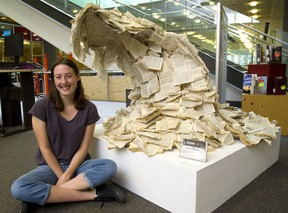 Kaitlyn German, 17 of Beal Art is proud that her Wave sculpture which is built out of over 200 paperbacks that were destined for the trash heap at the Stoney Creek library where she works. German saw the books as a perfect medium for her Beal Art project. (Mike Hensen/The London Free Press)