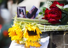 Photographs of Danforth shooting victim Reese Fallon, 18, are seen at a memorial remembering the victims of a shooting on Sunday evening on Danforth, Avenue in Toronto on Tuesday, July 24, 2018. THE CANADIAN PRESS/Mark Blinch