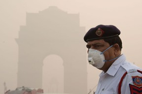 This photo taken on Nov. 9, 2017 shows an Indian police officer wearing a protection mask as he works near India Gate amid heavy smog in New Delhi. India's capital has reeled under dense smog that has disrupted air and railway services and forced residents to stay indoors or wear protection when they venture outside. The city's poor, by contrast, are often unable to buy suitable protection and unaware of the health dangers of the toxic air.         (DOMINIQUE FAGET/AFP/Getty Images)