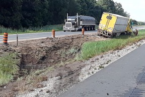 Handout/Chatham Daily News Chatham-Kent OPP say a high-tension cable barrier prevented this transport truck from crossing the median into oncoming traffic on Highway 401 near Kenesserie Road in east Chatham-Kent, Ont. on Saturday, August 18, 2018.