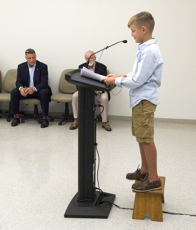 After Eric Lindros and Dr. Michael Strong addressed media to announce that the NHLPA Challenge raised $3.125 million for concussion research,  eleven-year-old Sheldon Geerts needed a  stool to reach the microphone to speak about his experiences with concussions Thursday at Western University. (Derek Ruttan/The London Free Press)