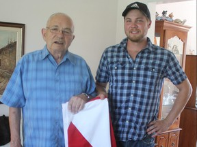 Gerald Hanley, left, and his nephew Stuart Hanley hold the flag that was draped over the casket of their uncle Private Henry Edmonds Priddle, who died 101 years ago in World War One. Priddle's remains were found recently and transferred to the CWGC Loos British Cemetery in Loos-en-Gohelle, France on Aug. 23 with Gerald and Stuart in attendance. (LAURA BROADLEY, Times-Journal)