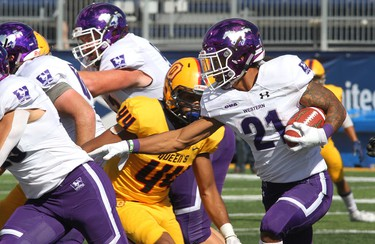 Western Mustangs running back Cedric Joseph rushed for 118 yards and a touchdown in Western's 26-23 win over the Queen's Gaels Saturday in Kingston. (Ian MacAlpine/The Whig-Standard)