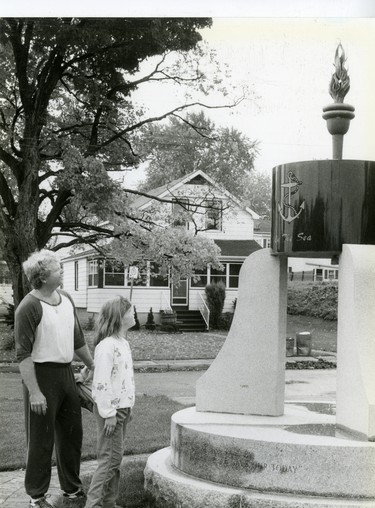 Norm Stormes and daughter Amanda look at the new cenotaph in Port Stanley, 1986. (London Free Press files)