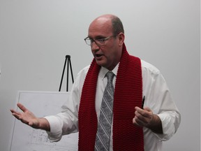Brian Lester, executive director of Regional HIV/AIDS Connection, an agency that runs the temporary supervised drug use site on King Street, speaks to residents at a community meeting to discuss the proposed permanent site at 446 York St. (Megan Stacey, The London Free Press)