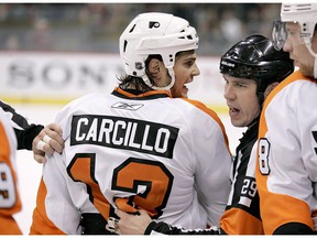Philadelphia Flyers left wing Daniel Carcillo is restrained by referee Ian Walsh (29) in the first period against the Minnesota Wild during a preseason NHL hockey game in St. Paul, Minn., on September 25, 2010. Daniel Carcillo spoke out about his experience with hazing while a member of the OHL's Sarnia Sting, detailing how he feels Canada's hockey culture needs to change.