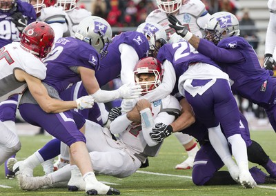 Guelph Gryphon quarterback Theodore Landers is crushed by five Western Mustangs during the Yates Cup OUA championship game at TD Stadium in London, Ont. on Saturday November 10, 2018. Western won the game 63-14. Derek Ruttan/The London Free Press/Postmedia Network