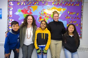 Northbrae teachers Jessica Albrecht and Laurie Welshman with some of their Nepalese students Saradhan Rai, Mahema Biswa and Samikchya Rai in London.  (Mike Hensen/The London Free Press)