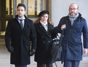 Miguel Chacon-Perez (left) leaves court with his mother Maria and lawyer Richard Posner after the second day of his second-degree murder trial in London. The crown alleges he stabbed 27-year-old Chad Robinson at a 2016 Christmas party. Derek Ruttan/The London Free Press/Postmedia Network