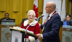 """Outgoing mayor Matt Brown introduces """"Mrs. Claus,"""" Jeanne Alpaerts who at 87 years old is with the Angels of the Night program and was being recognized for Senior of the Year at this council's last meeting.  Mike Hensen/The London Free Press/Postmedia Network"""