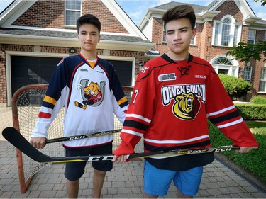 Ryan Suzuki, left, and his big brother Nick in the driveway of their family home in Byron on Thursday June 15, 2017. (Free Press file photo)