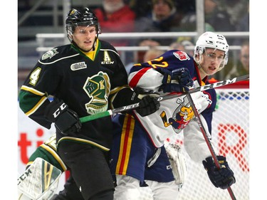 Will Lochead of the London Knights ties up Luke Bignell of the Barrie Colts during an early penalty kill after a high stick from Nathan Dunkley during the first period of their OHL game at Budweiser Gardens in London on Friday night.  (Mike Hensen/The London Free Press)