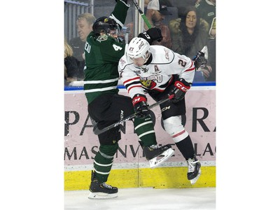 London Knight defenceman William Lochead collides in the corner with Aidan Dudas of the Owen Sound Attack  in London, Ont. on Friday February 8, 2019. (Derek Ruttan/The London Free Press)