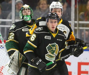 Joseph Raaymakers looks way up to see over Hamilton's captain Matthew Strome and Billy Moskal of the London Knights in the first period of their game at Budweiser Gardens on Friday  (Mike Hensen/The London Free Press)
