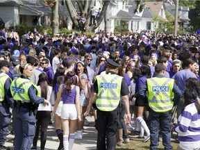 More than 5,000 Western University supporters  partied on Broughdale Avenue during Homecoming Weekend on Saturday, September 20, 2014. (DEREK RUTTAN/ The London Free Press)
