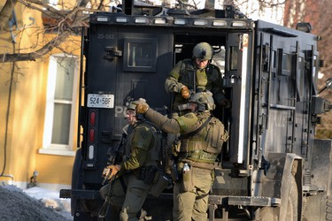"""Armed tactical officers were part of the """"containment"""" of a Main Street home in Listowel on Friday. Police had surrounded the house as part of an ongoing investigation of a wanted person. GALEN SIMMONS/STAFF REPORTER"""