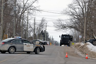 As part of their containment efforts Friday, Perth County OPP officers blocked off a section of Main Street in Listowel between Victoria and Barber avenues. Police were at the scene as part of an ongoing investigation of a wanter person. GALEN SIMMONS/BEACON HERALD