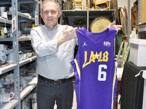 Stratford Perth Museum general manager John Kastner holds up the basketball jersey Justin Bieber wore while playing in the celebrity game during last year's NBA all-star festivities in Los Angeles at the museum on Tuesday February 5, 2019 in Stratford, Ont. (Terry Bridge/Stratford Beacon Herald)