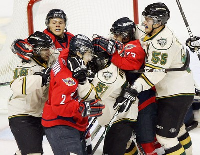 A melee of London Knight and Windsor Spitfire players in front of the Knights goal in the second period of their game at the John Labatt Centre on Friday, September 18, 2009.
