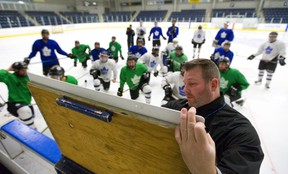 London Nationals assistant coach Randy Wilcox outlines some drills at their practice at the Western Fair Sports Centre in London, Ont.  (Mike Hensen/The London Free Press)