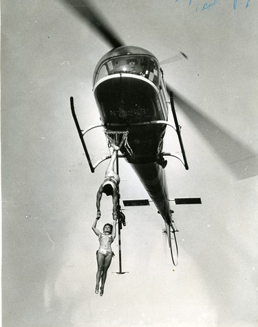 Aerialists: Frank Clark marries Ruthie Engford dangling from a helicopter above Western Fair, 1966. (London Free Press files)