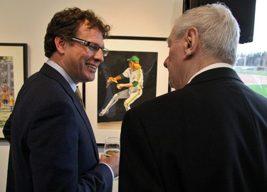 Canadian Baseball Hall of Fame chair Adam Stephens and Hall of Famer Ron Taylor look at a painting of a different Ron Taylor. (Cory Smith/Postmedia Network)