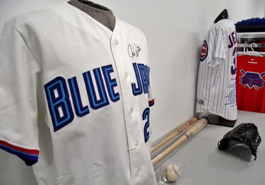 Autographed jerseys and bats are among the artifacts in the Harry Simmons Memorial Library. (Cory Smith/Postmedia Network)