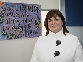 Psychiatrist Sandra Northcott stand in front of artwork done by a patient in Parkwood Institute's mental health care building. (Derek Ruttan/The London Free Press)