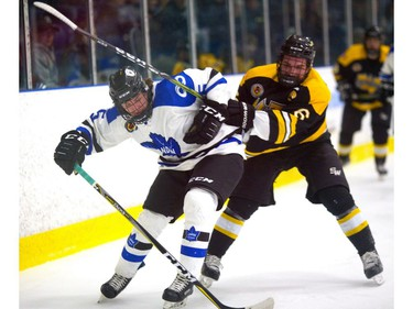 Adam Keyes of the London Nationals gets a rough ride from Alex Cimino of the Waterloo Siskins as Waterloo opened a 5-1 lead by the end of the second in the first game of their Sutherland Cup final on Thursday at Western Fair.  (Mike Hensen/The London Free Press)
