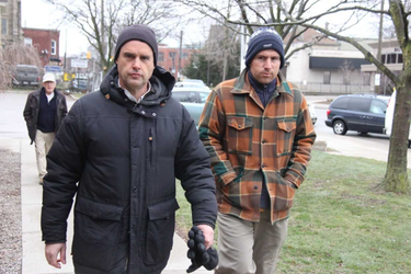 London residents Steven Ravbar, 50, and Matthew Anthony Carapella, 32, who have been charged under a city hall nuisance bylaw, walk into a London court Monday to answer to the charges. JONATHAN JUHA/THE LONDON FREE PRESS