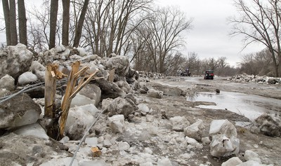 City of Brantford operational services crews have started clearing the ice jam on Gilkison Street in Brantford. About 1,200 tons of ice have been hauled away to the Earl Avenue snow dump facility over the past four days. Gilkison Street will reopen once road repairs have been completed and deemed safe for pubic use. Brantford Parks and Recreation anticipates the adjacent trails at Gilkison Flats will reopen in mid- to late-April.  Brian Thompson/The Expositor  ORG XMIT: POS1903141622142527