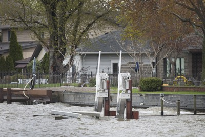 WINDSOR, ONT:. MAY 7, 2019 - High water levels in the Detroit River overtake a dock at a home east of Shanfield Shores Park, Tuesday, May 7, 2019.  (DAX MELMER/Windsor Star)