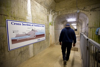 Jeff Cantelon, a dam maintenance worker for the Upper Thames River Conservation Authority (UTRCA) walks through an inspection tunnel in Fanshawe Dam 30 metres below the road surface. These tunnels allow inspection of the dam constructed in 1950-52 at a cost of $5 million (structure and land) Mike Hensen/The London Free Press/Postmedia Network
